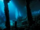 Divers inside the hold of the Tabarka wreck, Scapa Flow