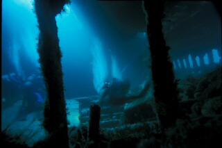 Divers inside the hold of the Tabarka, Scapa Flow
